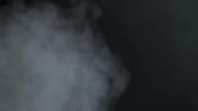 White Smoke On Black Background: Stock Video