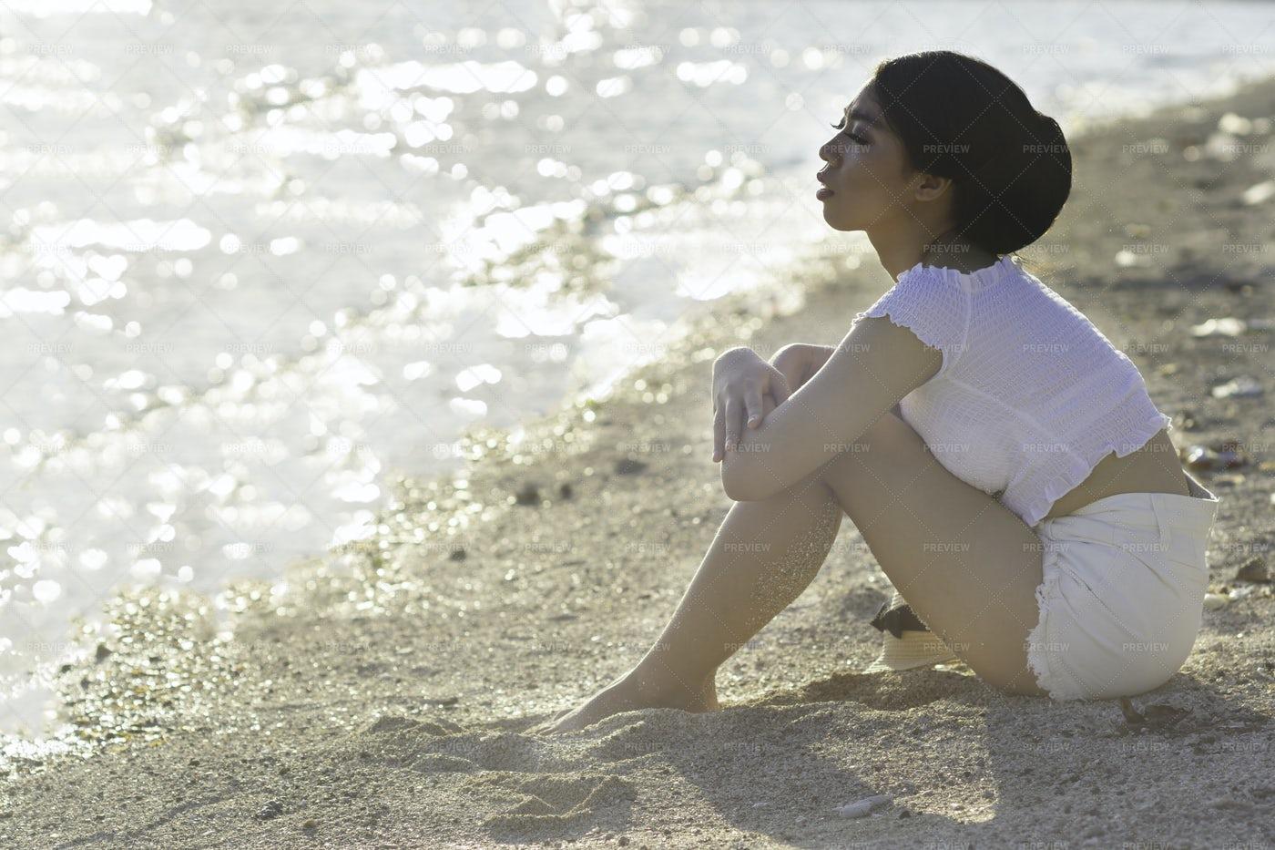 Sitting On A Sandy Beach: Stock Photos