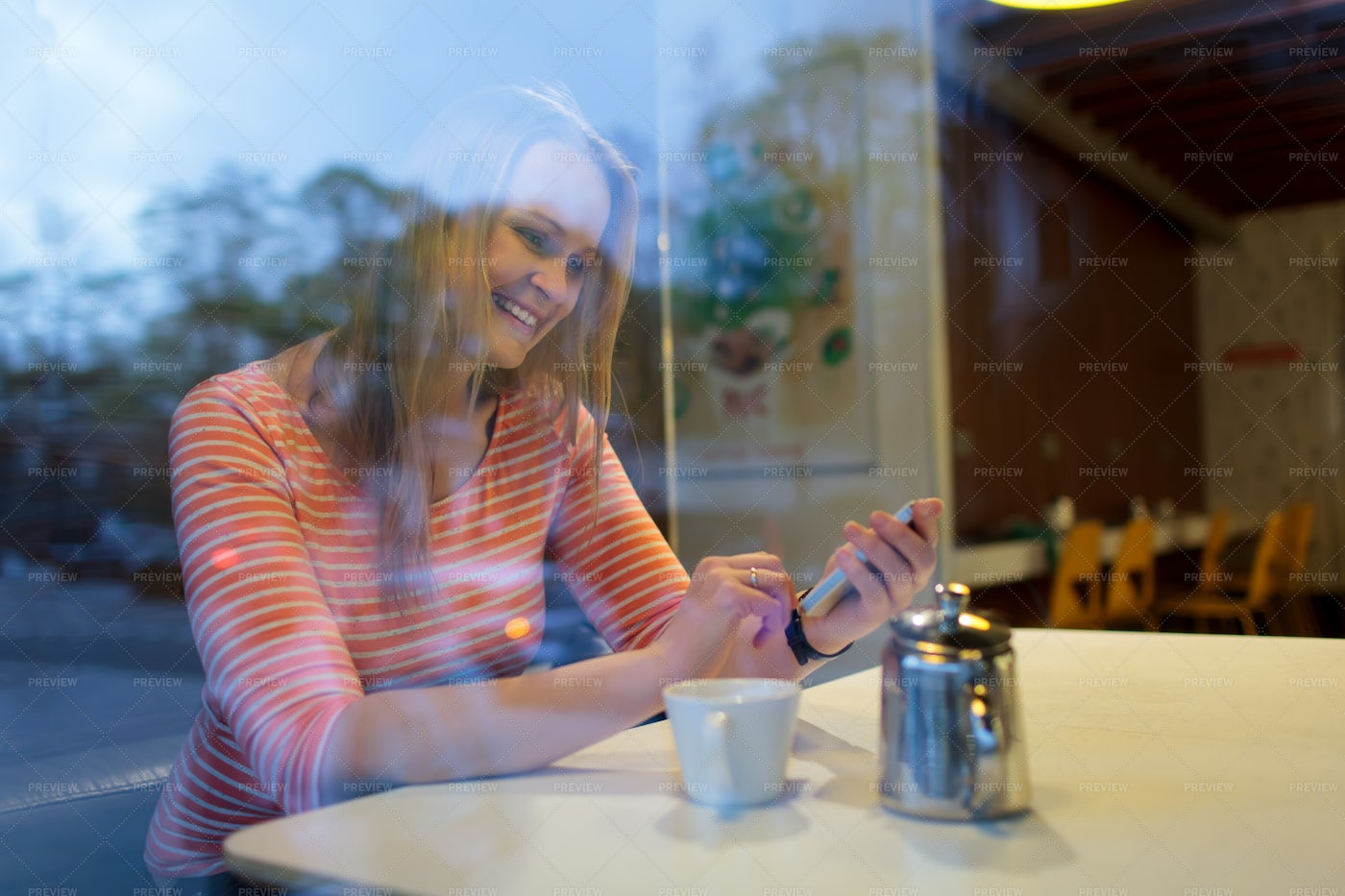 Woman Using A Mobile Phone In Cafe: Stock Photos