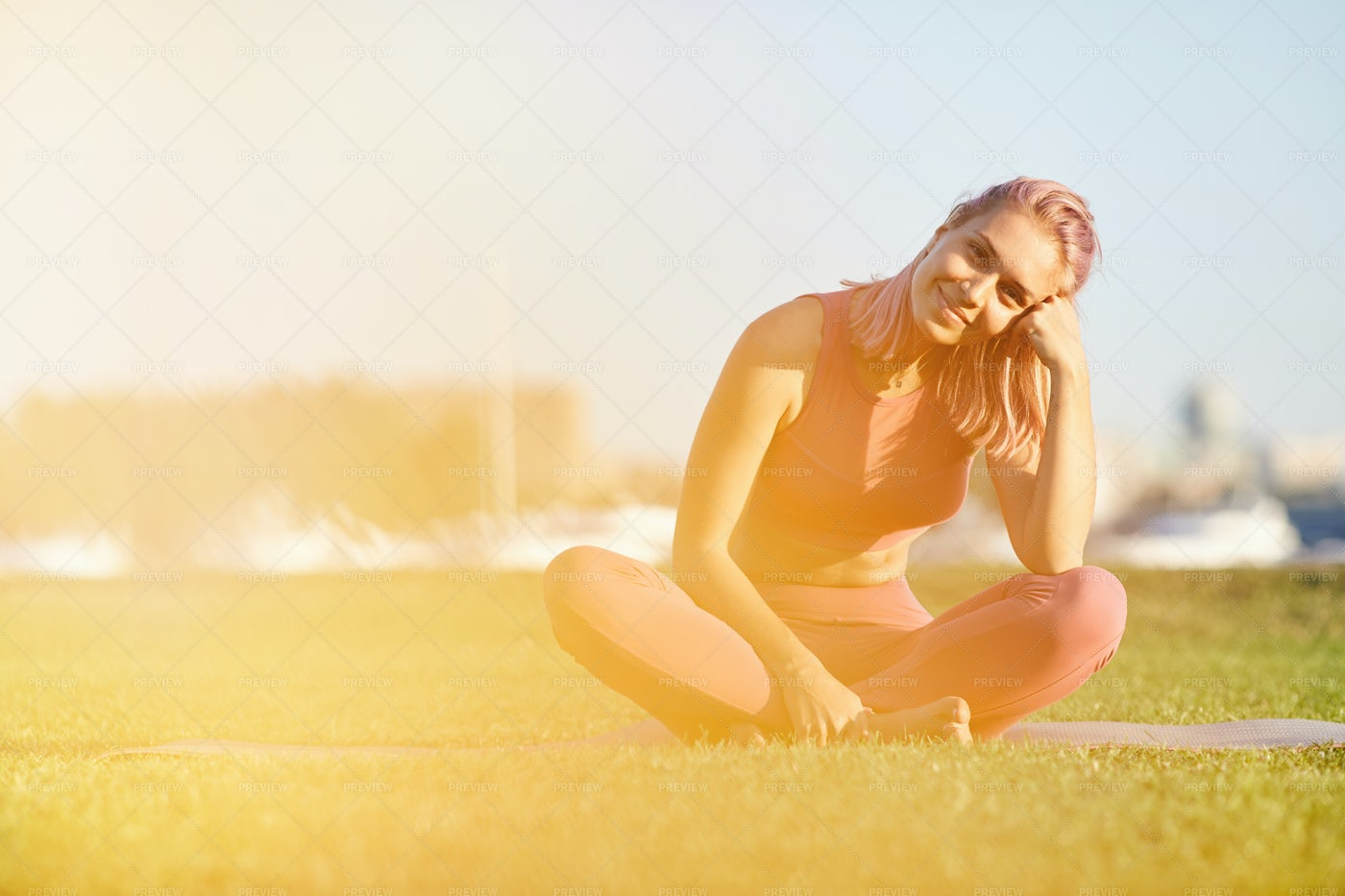 Happy Woman Resting On The Grass: Stock Photos