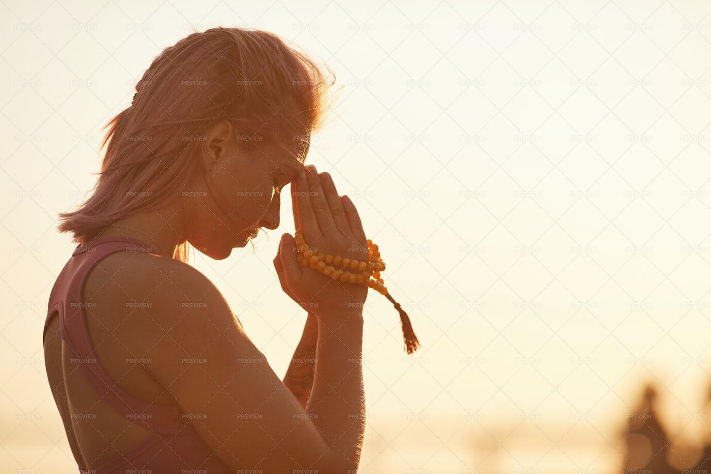 Doing Yoga During Sunset: Stock Photos
