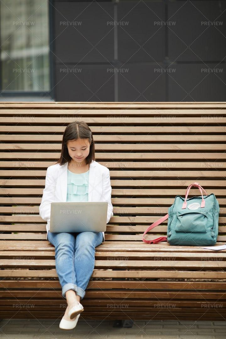 Schoolgirl Working On Her Laptop: Stock Photos
