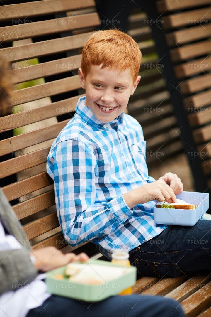 Boy Having Lunch Outdoors: Stock Photos