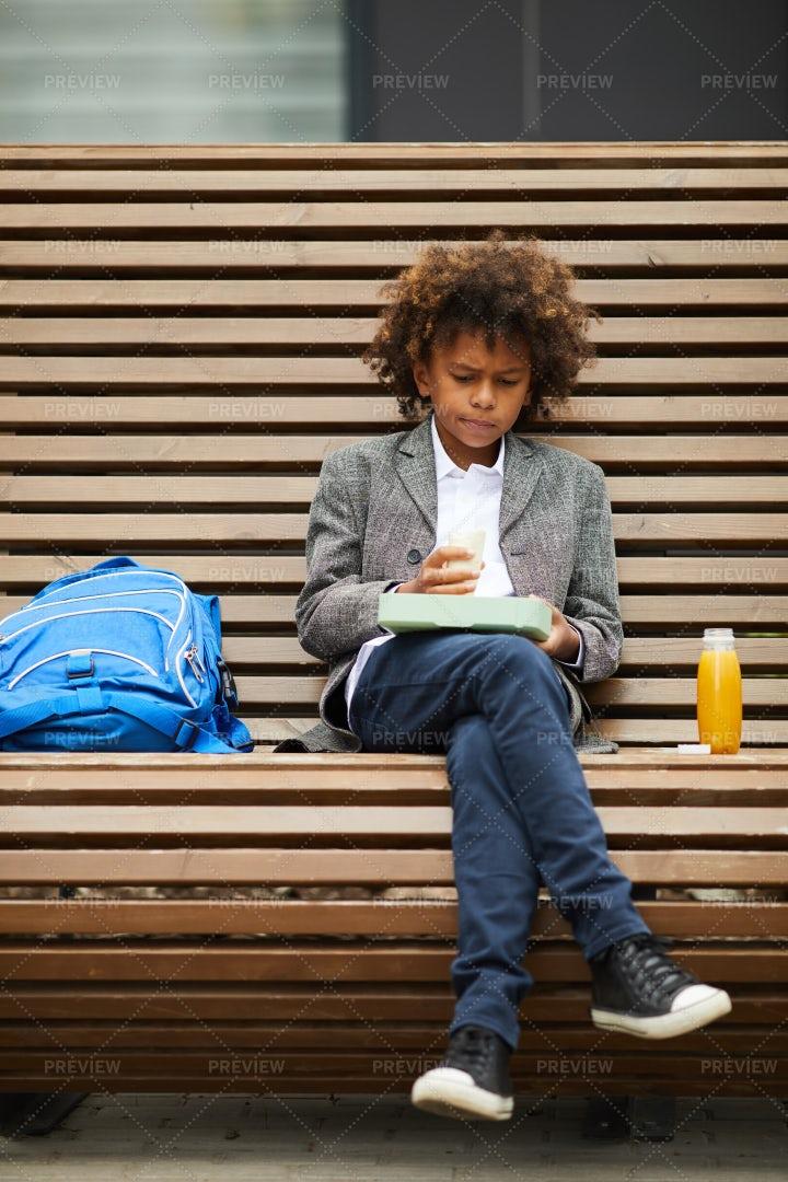 Boy Having Lunch Alone: Stock Photos