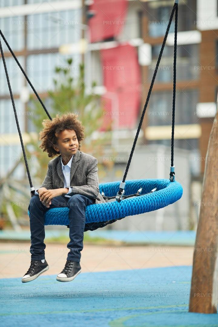 Boy On A Swing: Stock Photos