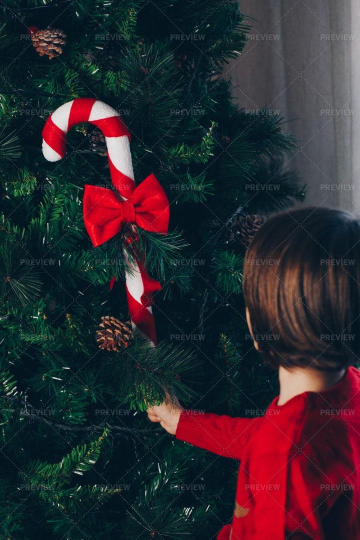 Child Decorating A Christmas Tree: Stock Photos