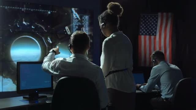 People Managing A Space Mission: Stock Video
