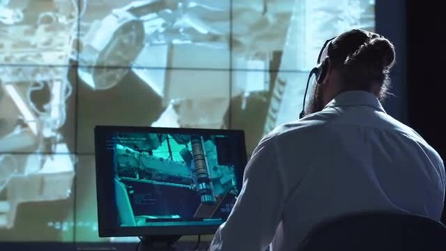 Man Working In Control Center: Stock Video