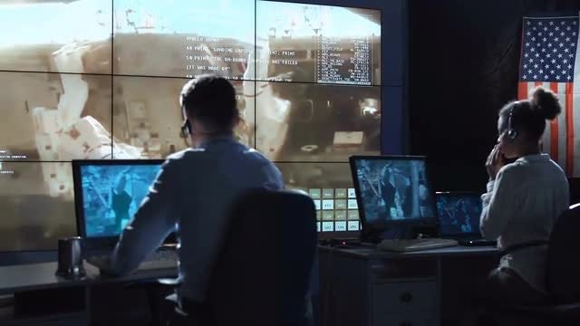 Workers In Mission Control Center: Stock Video