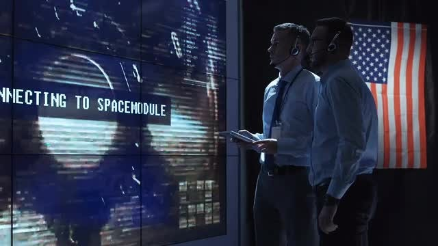 People Controlling  A Landing Spacecraft : Stock Video