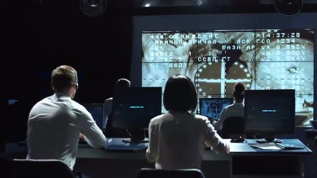 Workers Celebrating In Control Center.: Stock Video
