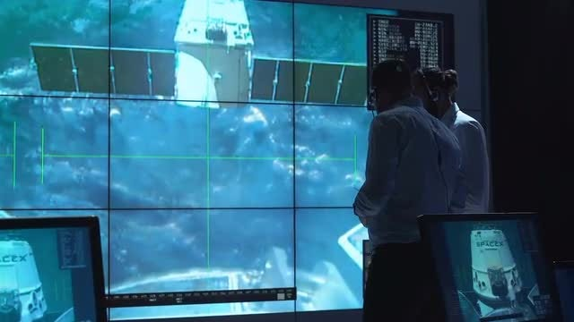 Mission Controllers Watching Ship Undock: Stock Video