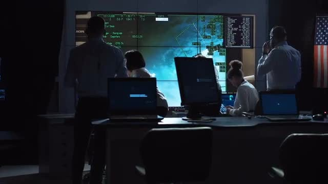 Staff In Mission Control Center: Stock Video