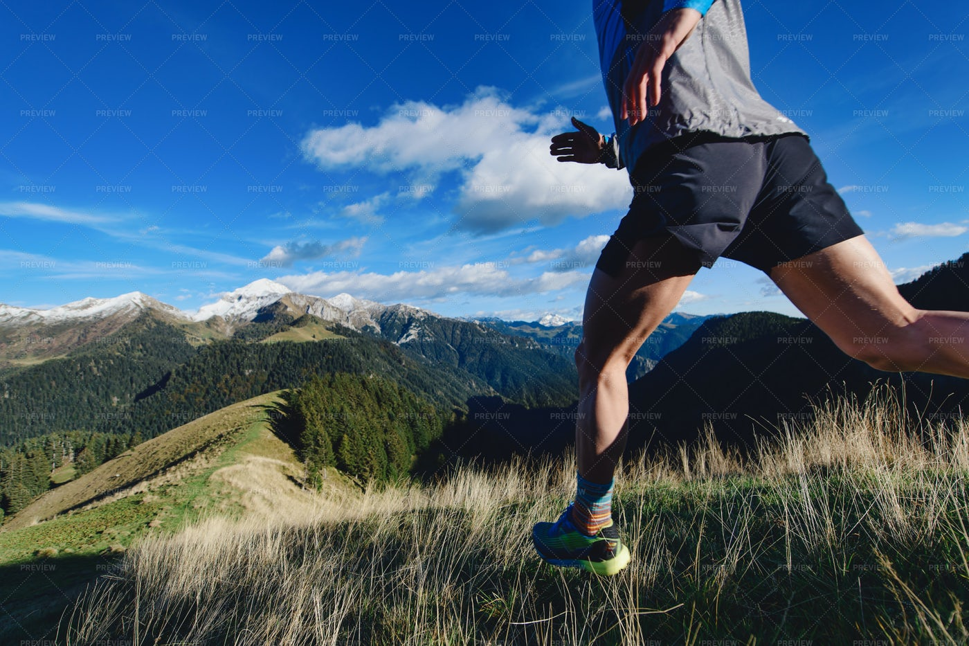 Runner During Downhill Workout: Stock Photos