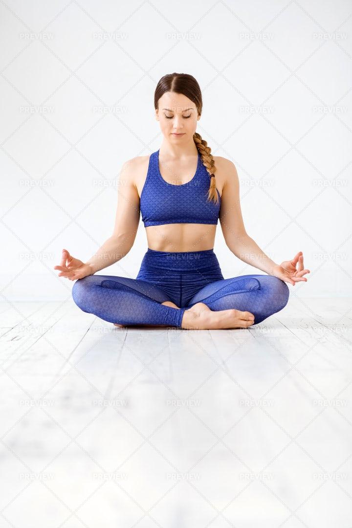 Fit Young Woman Meditating: Stock Photos