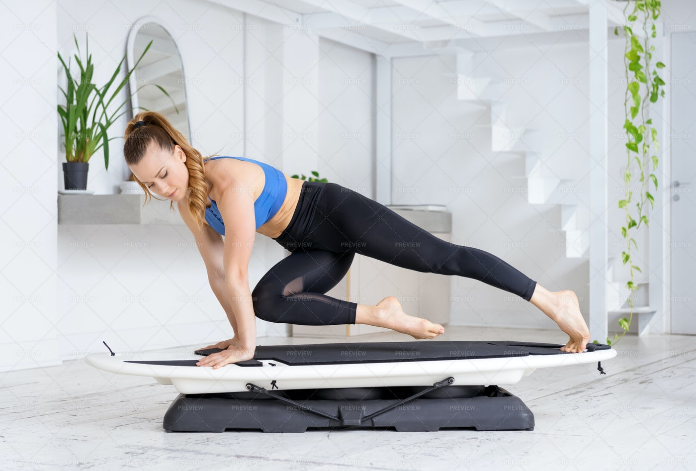 Athlete Doing A High Plank Cross Spider: Stock Photos