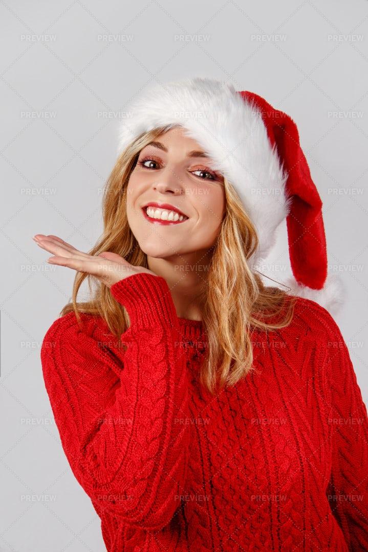 Woman In Santa Hat Smiling: Stock Photos