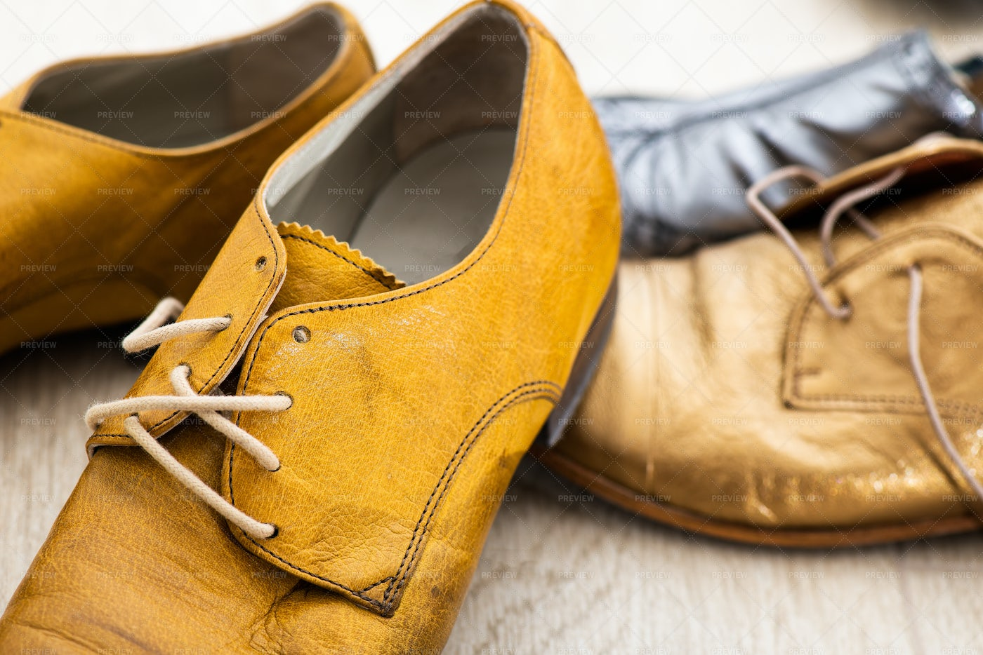 Shoes With Yellow Strings: Stock Photos