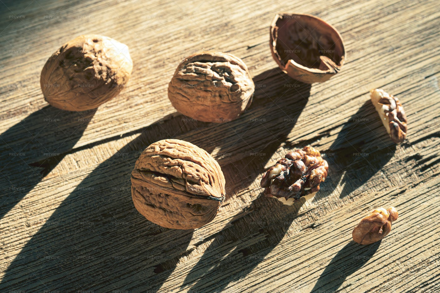 Walnuts On Wooden Surface: Stock Photos