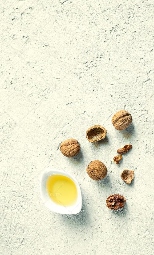 A White Bowl With Walnut Oil: Stock Photos