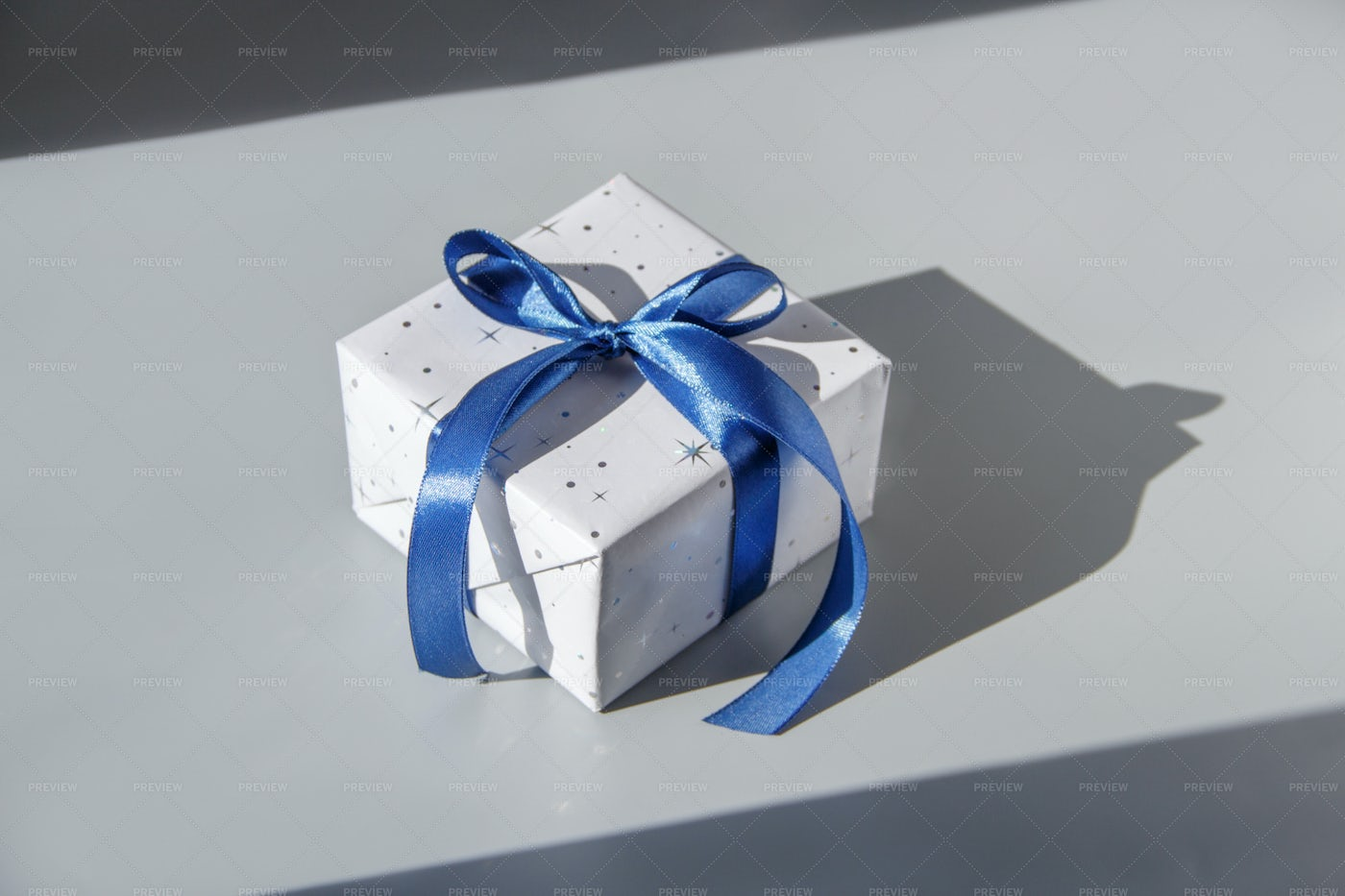 Gift Box With A Blue Ribbon: Stock Photos