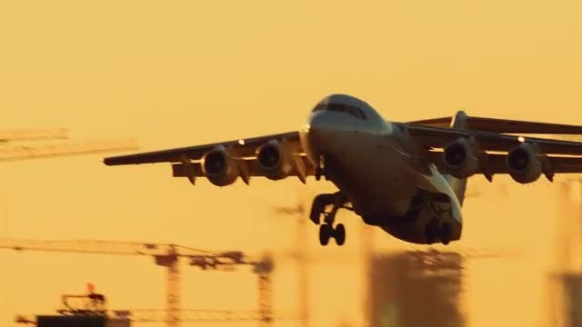 Airliner Taking Off At Sunset: Stock Video