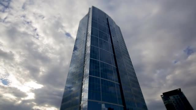Skyscraper Among Clouds Tilt Shift Time Lapse: Stock Video