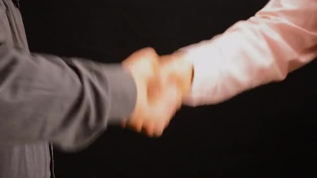 Men Exchanging Firm Handshake: Stock Video