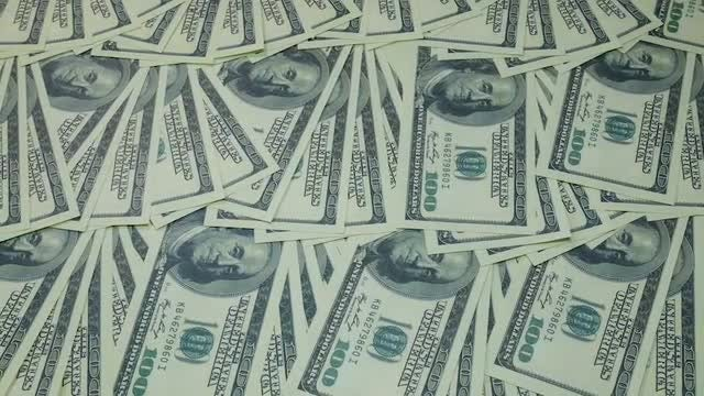 Panning Shot Of Dollar Notes: Stock Video