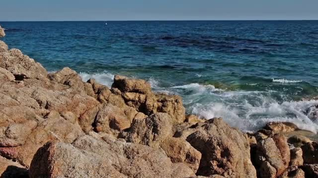 Ocean Waves Crashing Into Rocks: Stock Video