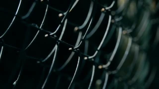 POV Of Wire Mesh Fence: Stock Video