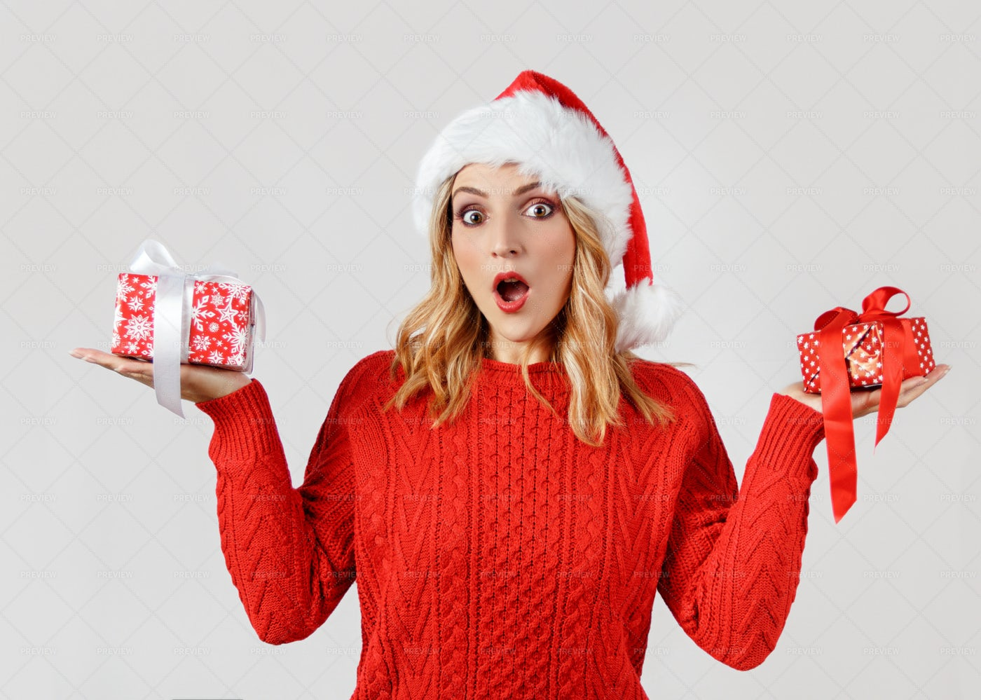 Surprised Woman With Gifts: Stock Photos
