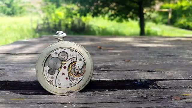 Clock Mechanism On Wooden Surface: Stock Video