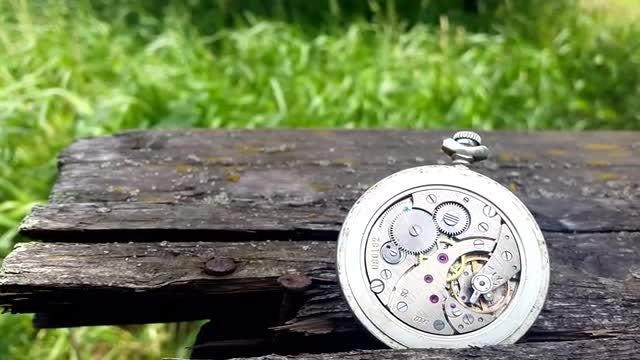 Clock Mechanism On Wooden Background: Stock Video