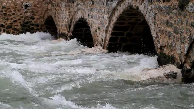 Water Under An Ancient bridge : Stock Video