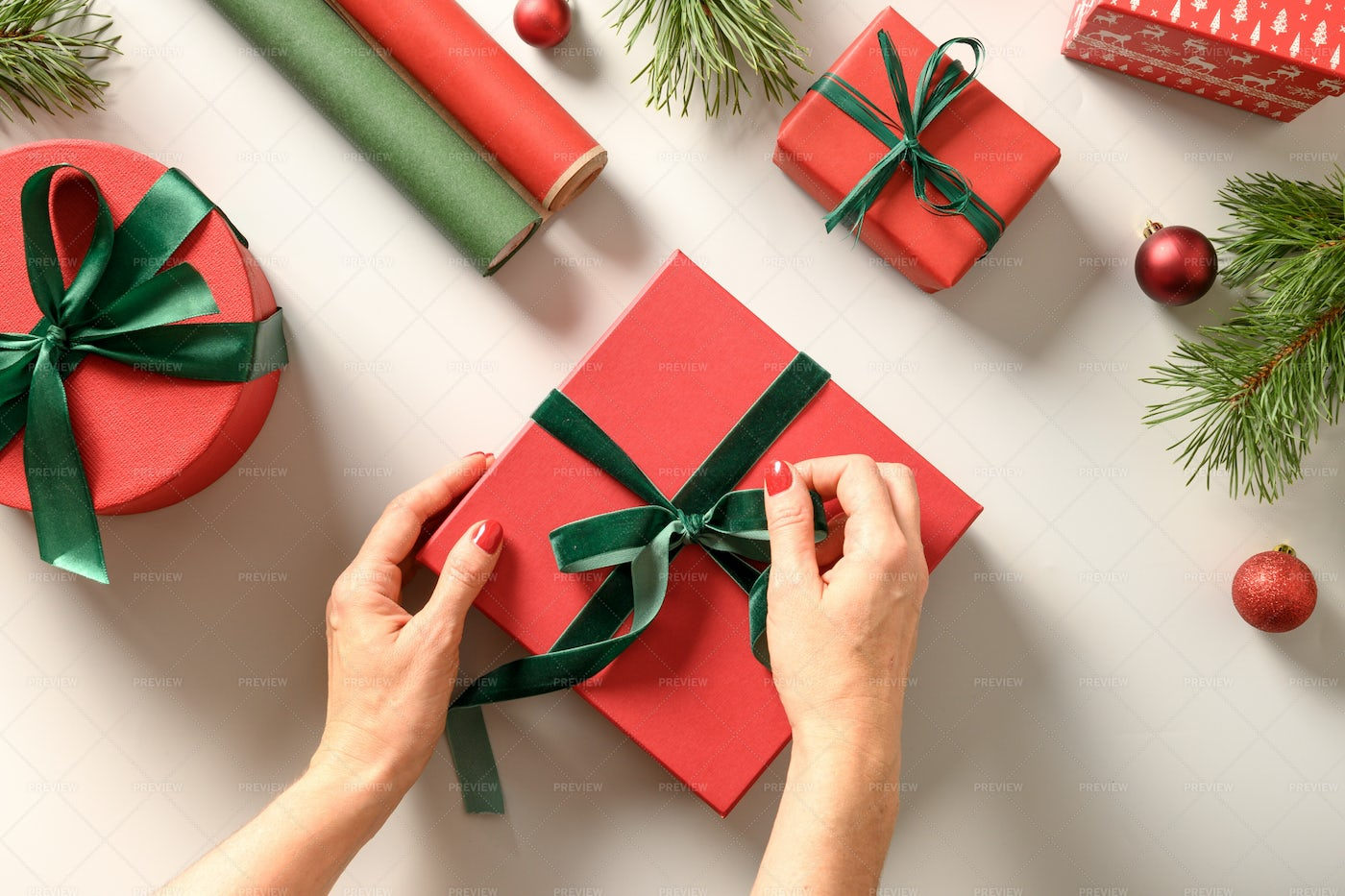 Woman Wrapping Christmas Gifts: Stock Photos