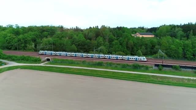 Train Passing By Large Park: Stock Video