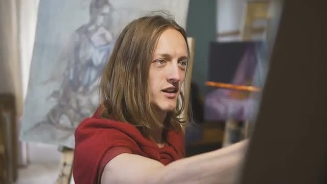 Male Artist Smiles While Painting : Stock Video
