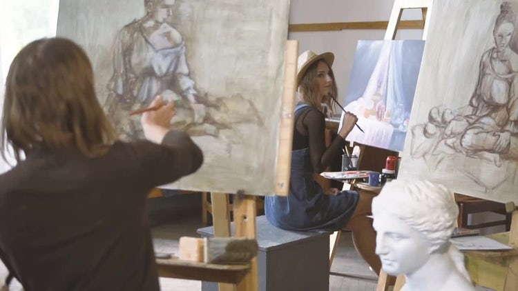 Inspired Artists Drawing In Studio: Stock Video