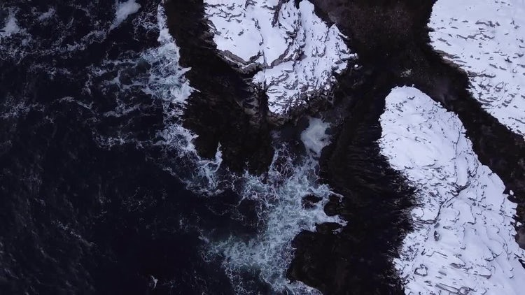 Ocean Waves On Snowy Rocks: Stock Video