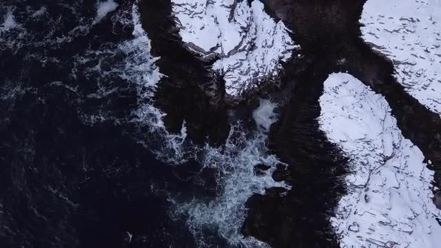 Ocean Waves On Snowy Rocks: Stock Video