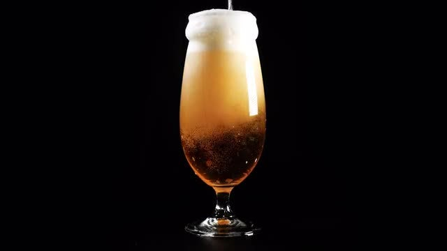 Cold Beer Poured Into Glass: Stock Video