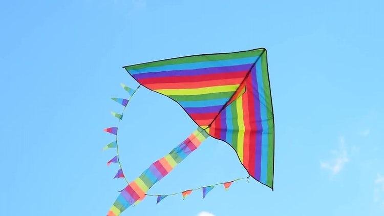Rainbow Kite Against Blue Sky: Stock Video