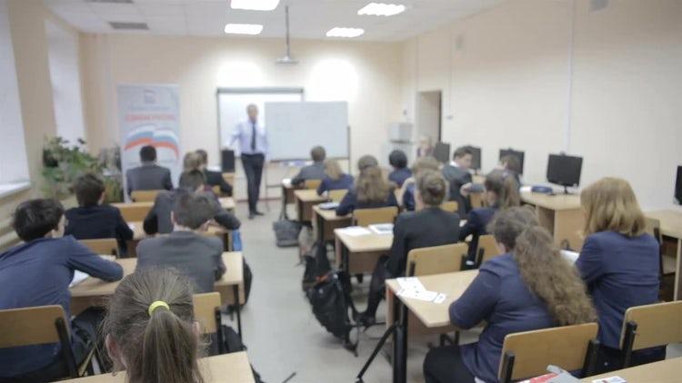 Teacher Teaches In The Classroom: Stock Video