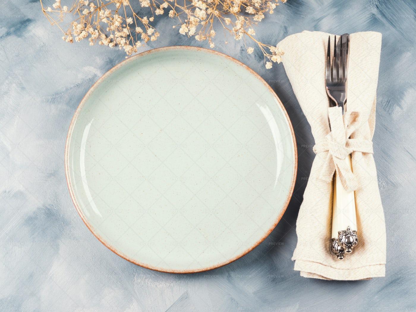 Blue Dish And Silverware: Stock Photos