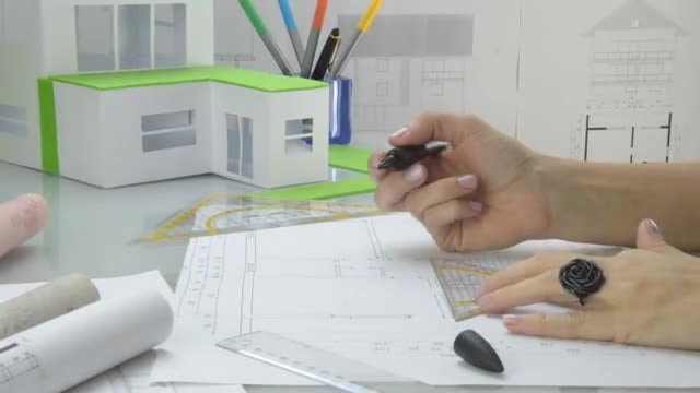 Woman Architect Draws Plans: Stock Video