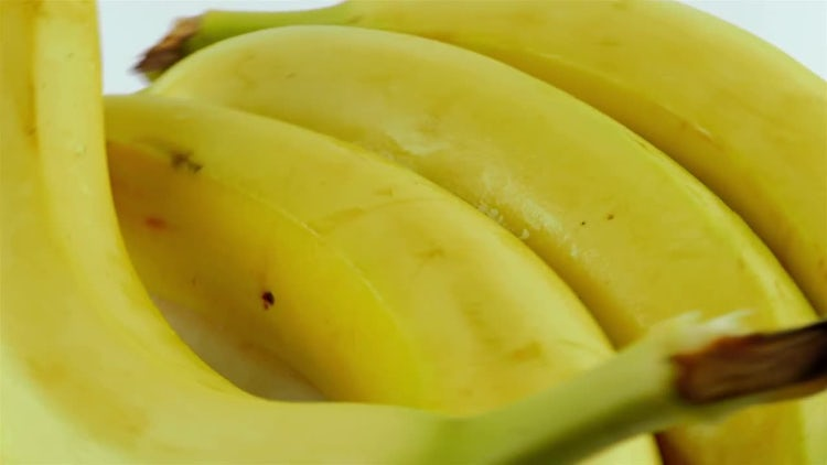 Rotating Bananas On White Background: Stock Video