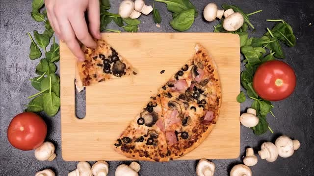 Hand Taking Slices Of Pizza: Stock Video