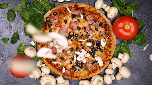 Mushrooms Falling On Cooked Pizza: Stock Video