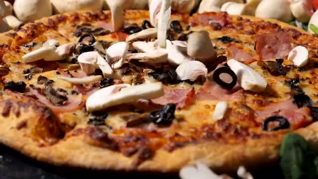 Raw Mushrooms Falling On Pizza: Stock Video